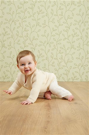 Baby girl crawling on floor Stock Photo - Premium Royalty-Free, Code: 649-06812528