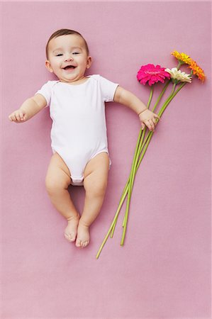 Baby girl with gerbera flowers Stock Photo - Premium Royalty-Free, Code: 649-06812538