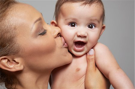 Mother kissing her baby girl Stock Photo - Premium Royalty-Free, Code: 649-06812545