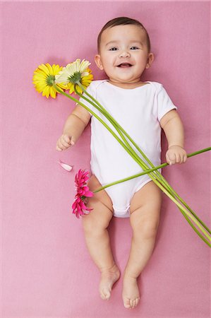 Baby girl with gerbera flowers Stock Photo - Premium Royalty-Free, Code: 649-06812540