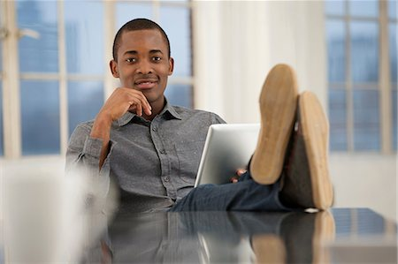 sole - Male office worker sitting at desk with feet up Stock Photo - Premium Royalty-Free, Code: 649-06812625