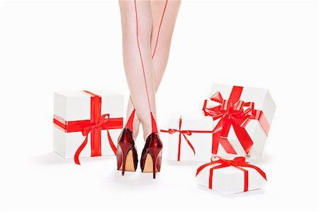 stocking feet - Woman wearing red stilettos with gift boxes Stock Photo - Premium Royalty-Free, Code: 649-06812633