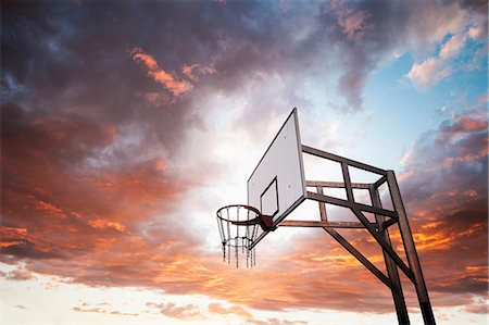 Basketball hoop and dramatic sky Stock Photo - Premium Royalty-Free, Code: 649-06812729