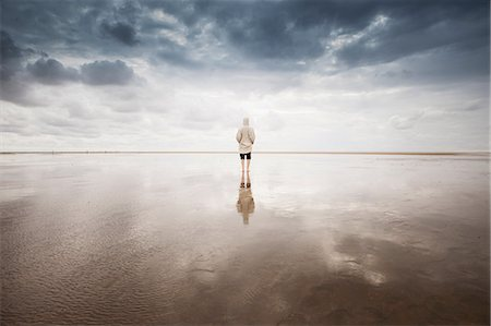 space - Woman on beach, Schleswig Holstein, Germany Stock Photo - Premium Royalty-Free, Code: 649-06812732