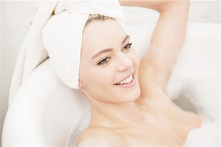 Woman in bubble bath with towel on head Stock Photo - Premium Royalty-Free, Code: 649-06812763
