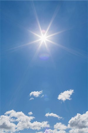 Fluffy clouds blue sky and sunlight Stock Photo - Premium Royalty-Free, Code: 649-06812957