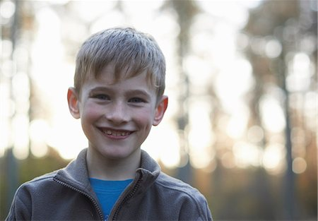 portrait smile caucasian one - Portrait of boy in forest Stock Photo - Premium Royalty-Free, Code: 649-06812993