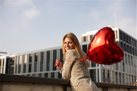 Woman with red heart-shaped balloon Stock Photo - Premium Royalty-Free, Code: 649-06813029