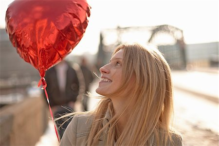 Woman with red heart-shaped balloon Stock Photo - Premium Royalty-Free, Code: 649-06813030