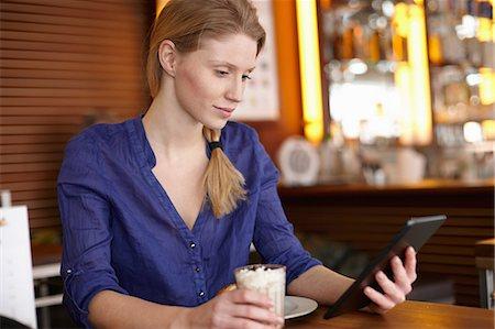 Woman using digital tablet Stock Photo - Premium Royalty-Free, Code: 649-06813031