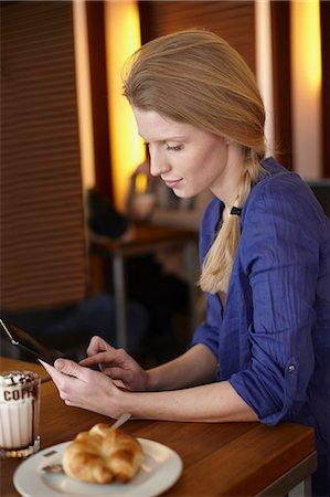 Woman using digital tablet Stock Photo - Premium Royalty-Free, Code: 649-06813032