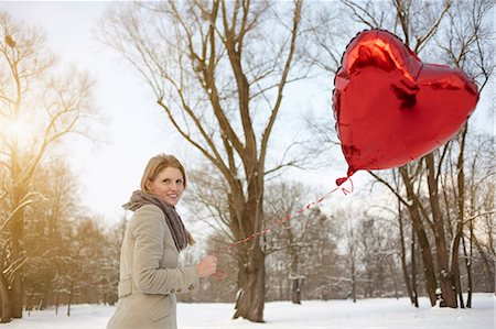 Woman with red heart-shaped balloon Stock Photo - Premium Royalty-Free, Code: 649-06813033