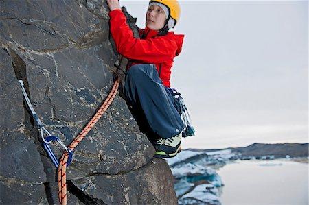 dependable - Woman rock climbing, Svinafellsjokull glacier, Skaftafell national park, Iceland Stock Photo - Premium Royalty-Free, Code: 649-06813152