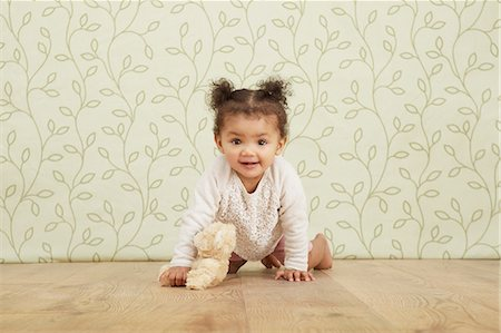 Portrait of baby girl taking crawling Stock Photo - Premium Royalty-Free, Code: 649-06829432