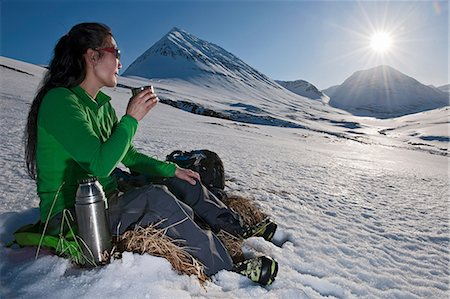 extreme terrain - Mature woman sitting with a hot drink in snowy mountains, Skidadalur, Dalvik, Iceland Stock Photo - Premium Royalty-Free, Code: 649-06829446
