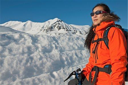 Mature woman hiking in snowy mountains, Skidadalur, Dalvik, Iceland Stock Photo - Premium Royalty-Free, Code: 649-06829442