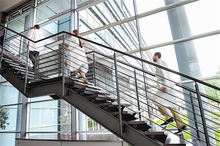 people hospital - Doctors rushing up hospital staircase, blurred motion Stock Photo - Premium Royalty-Free, Code: 649-06829492
