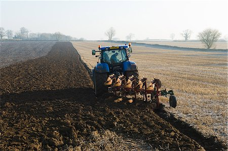 plow - Tractor ploughing the ground of field Stock Photo - Premium Royalty-Free, Code: 649-06829521