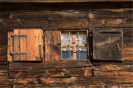 Wooden shutters open on cabin in Alp Devero, Alpi, Piedmont, Italy Stock Photo - Premium Royalty-Free, Code: 649-06829530