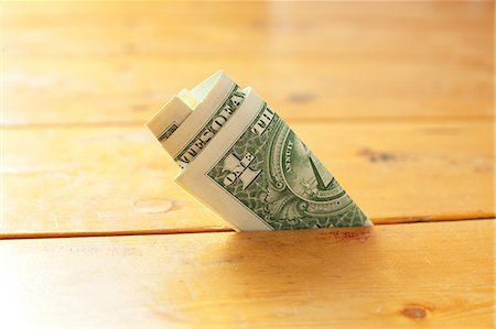 One dollar bill in between floorboards Stock Photo - Premium Royalty-Free, Code: 649-06829564