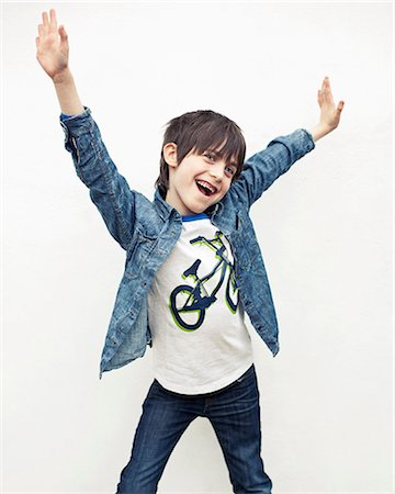 funky - Portrait of boy with arms out against white background Stock Photo - Premium Royalty-Free, Code: 649-06829572