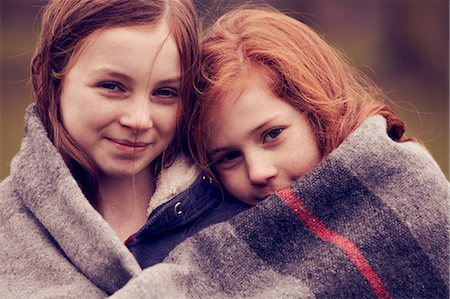 red hair preteen girl - Portrait of girls wrapped in a blanket outdoors Stock Photo - Premium Royalty-Free, Code: 649-06829594