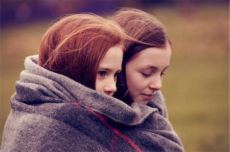 red hair preteen girl - Girls wrapped in a blanket outdoors Stock Photo - Premium Royalty-Free, Code: 649-06829595