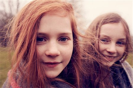 red hair preteen girl - Portrait of girls wrapped in a blanket outdoors, smiling Stock Photo - Premium Royalty-Free, Code: 649-06829597