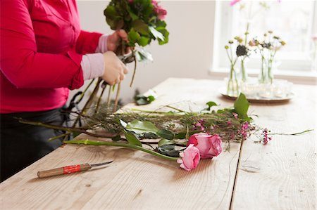 florist - Close up of young woman arranging fresh flowers into bouquet Stock Photo - Premium Royalty-Free, Code: 649-06829648