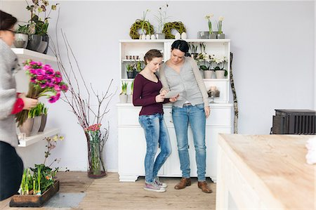 florist - Mid adult woman and teenage girl in florists Stock Photo - Premium Royalty-Free, Code: 649-06829655