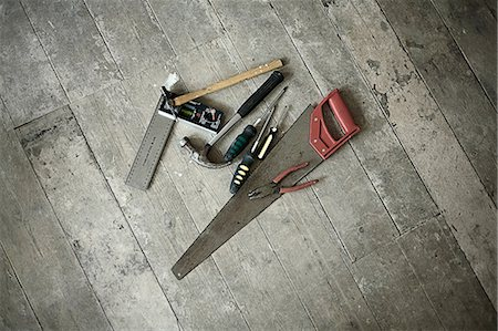 Tools on wooden floorboards of new home Stock Photo - Premium Royalty-Free, Code: 649-06829739
