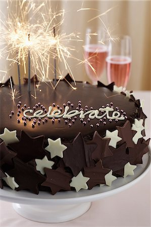 Chocolate cake with word 'celebrate' and sparklers Stock Photo - Premium Royalty-Free, Code: 649-06830082