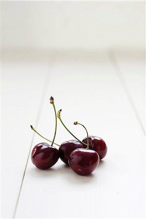 Four cherries Stock Photo - Premium Royalty-Free, Code: 649-06830113