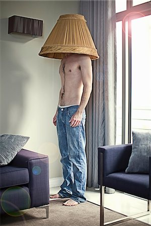 quirky - Young man wearing lampshade on head Stock Photo - Premium Royalty-Free, Code: 649-06844005