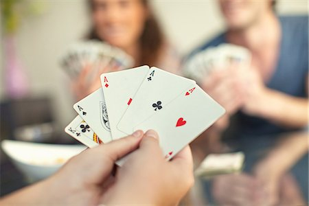 People playing cards Stock Photo - Premium Royalty-Free, Code: 649-06844007