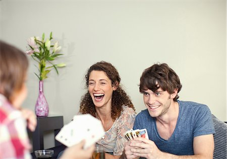 Friends playing cards Stock Photo - Premium Royalty-Free, Code: 649-06844008