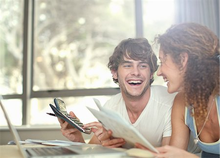 Happy young couple planning finances Stock Photo - Premium Royalty-Free, Code: 649-06844011