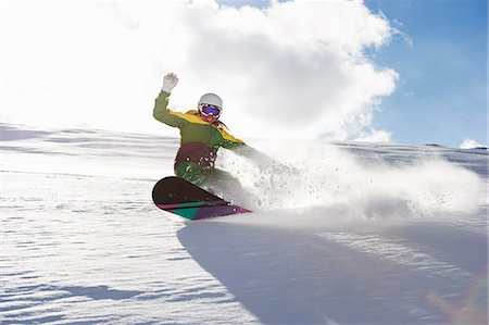 Young woman snowboarding Stock Photo - Premium Royalty-Free, Code: 649-06844032