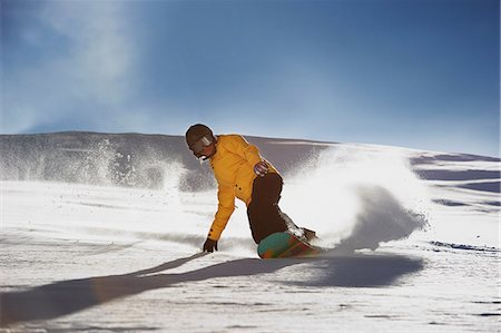 Young woman snowboarding Stock Photo - Premium Royalty-Free, Code: 649-06844033