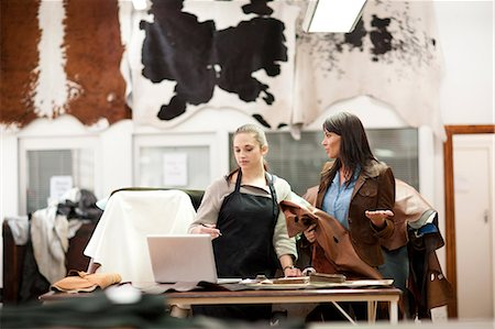 Worker and customer in leather workshop Stock Photo - Premium Royalty-Free, Code: 649-06844097