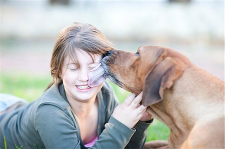 Dog licking girl's face Stock Photo - Premium Royalty-Free, Code: 649-06844128