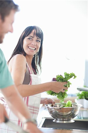 Couple preparing food Stock Photo - Premium Royalty-Free, Code: 649-06844144