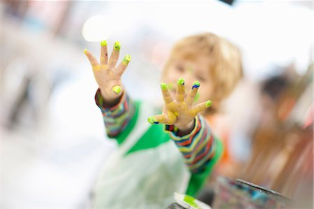 finger painting - Boy with paint on his hands Stock Photo - Premium Royalty-Free, Code: 649-06844166