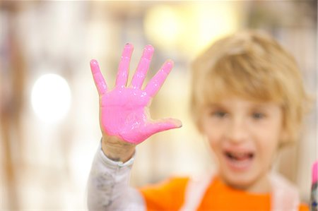 paint - Boy with pink paint on his hand Stock Photo - Premium Royalty-Free, Code: 649-06844167