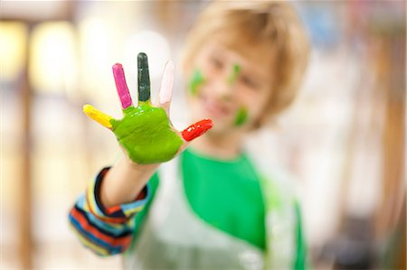 painted - Boy with paint on his hand Stock Photo - Premium Royalty-Free, Code: 649-06844171