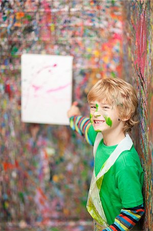 painted - Boy pointing to painting on paint-splattered wall Stock Photo - Premium Royalty-Free, Code: 649-06844172