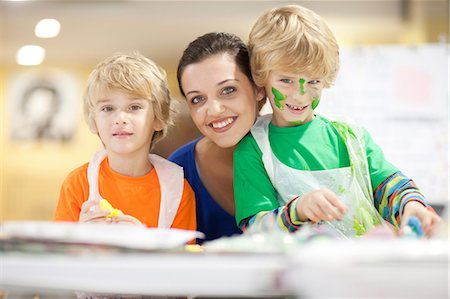 Young woman and boys in art class Stock Photo - Premium Royalty-Free, Code: 649-06844173