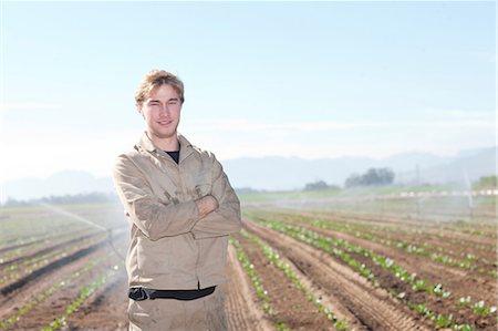 farming (raising livestock) - Young man in potato field, portrait Stock Photo - Premium Royalty-Free, Code: 649-06844232