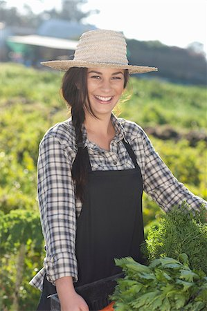 farmhand (female) - Young woman with vegetables grown at farm Stock Photo - Premium Royalty-Free, Code: 649-06844244