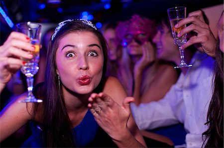 Young woman blowing kiss in limousine Stock Photo - Premium Royalty-Free, Code: 649-06844364